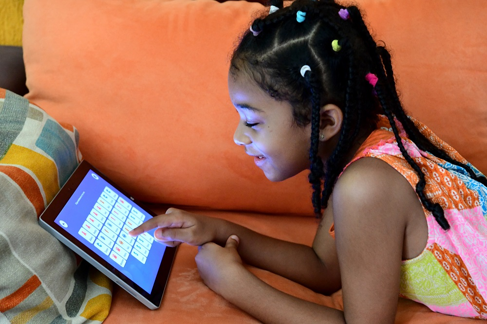Child learning on a mobile device